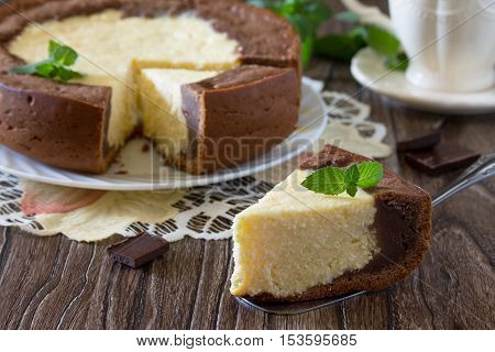 Pastry With Cheese And Chocolate Cheesecake On A Wooden Table.