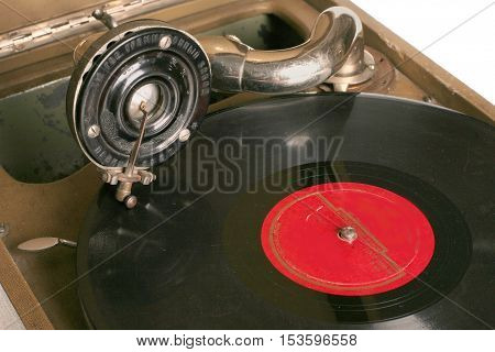 Vinyl analog player. Turntable playing vinyl record with music