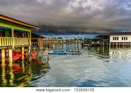 Federal Territory of Labuan, Malaysia. Oct 27 2016 : The shelf cloud pass through to the water village Kampung Patau - Patau 2 bring thunderstrom and heavy rain.