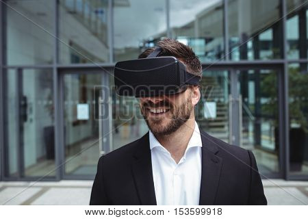 Businessman using reality virtual headset in office building
