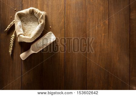 wheat flour on wooden background texture