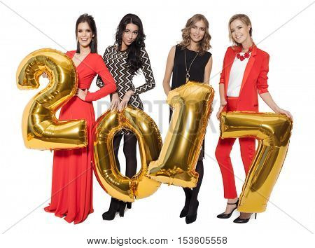 Charming Women Holding Big Golden Numbers 2017. Happy New Year. Marry Christmas. Isolated.