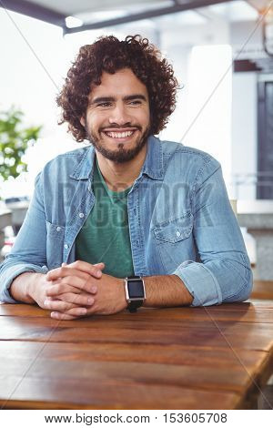 Man sitting and smiling in cafeteria