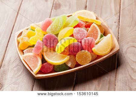 Colorful marmalade on wooden background