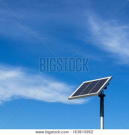 Single solar panel against clear blue sky
