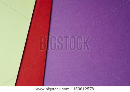 Colored cardboards background in green red purple tone. Copy space. Horizontal