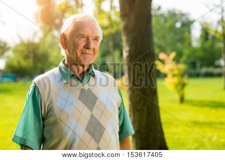 Older man outdoor. Senior male looking aside. Save kindness inside yourself. Bright thoughts and good intentions.