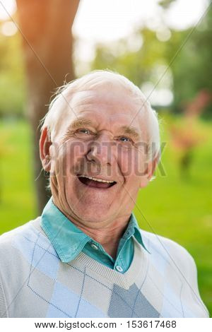Old man laughing. Portrait of elderly male. Cheerful pages of my memory. Everything is changing so quickly.