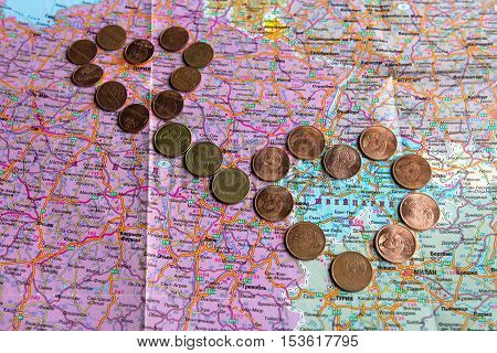 A fragment of the tourist cards and money coins, original background