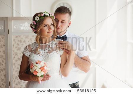 Wedding Couple Indoors Is Hugging Each Other.