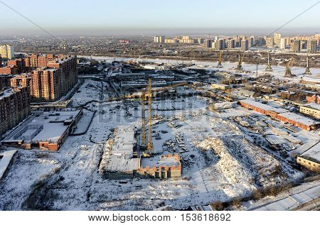 Tyumen, Russia - December 2, 2015: Aerial view on Tychkovka residential district, construction site of residential house, plant on production of prestarting heaters of engine and Tyumen river port