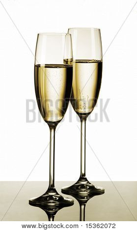 Two glasses of champagne - isolated on white background