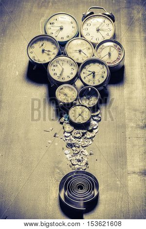 Old clocks and the parts, concept made of old clocks and watches