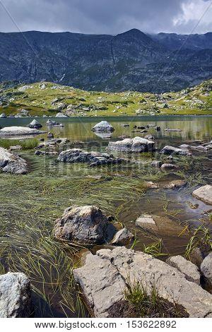 Stones in the water of The Trefoil lake, Rila Mountain, The Seven Rila Lakes, Bulgaria