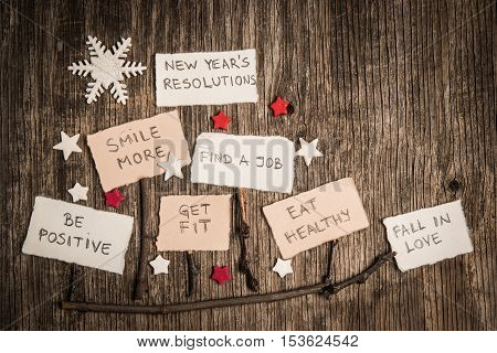 Christmas Sleds Made Of Branches And New Year Resolutions On Rustic Wooden Background