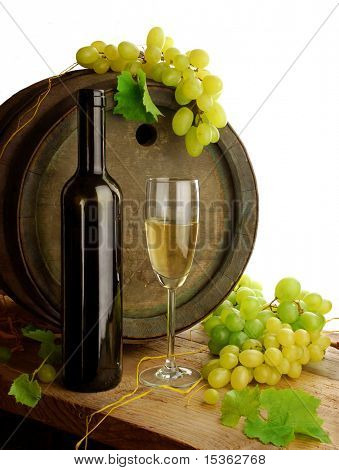 White wine, grapes and old barrel on white background