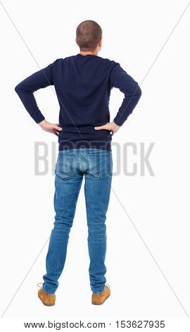 Back view of man in jeans. Standing young guy. Rear view people collection.  backside view of person.  Isolated over white background.  Man in warm jacket standing with hands on waist.