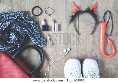 Flat lay photography with Halloween accessories cosmetics essential items for woman Overhead view of Halloween accessories items top view on wooden background