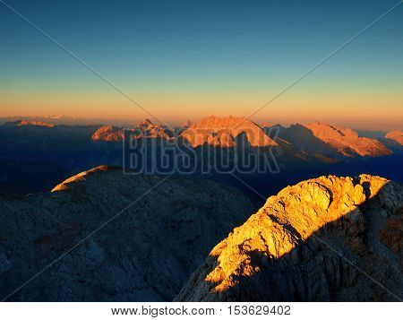 Morning Sun On  Alpine  Cliff And Night In Valley Bellow. Daybreak Sun