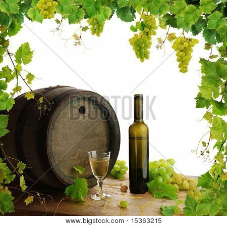 White wine still life with fresh grapevine border
