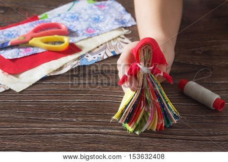 Protective Averter, Textile Doll Traditional Russian. Strips Of Fabric, Thread, Scissors On Wood Bac