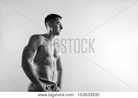 Close up of image of a handsome young muscular sports man.