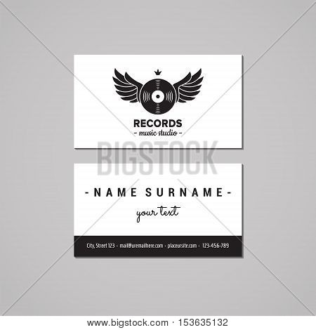 Music studio business card design concept. Logo with vinyl record and wings. Vintage hipster and retro style.