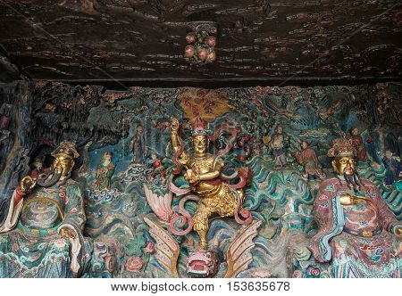 Statue of Kuixing god of fate at western hills, Yunnan, China