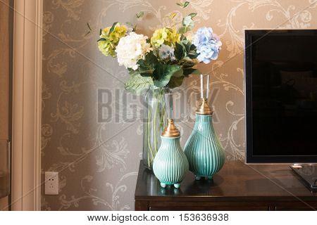 beautiful vases near TV in modern living room