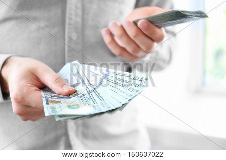 Man holding stack of money, closeup