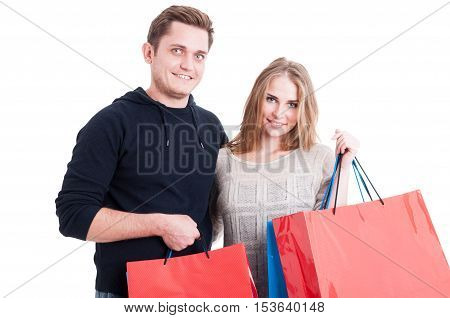 Attractive Couple Holding Bunch Of Shopping Bags