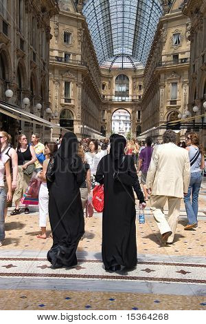 Italy, Milan, big trace center. moslem walking.