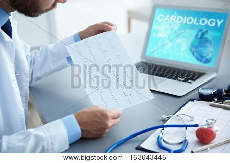 Cardiologist working at office. Health care concept.