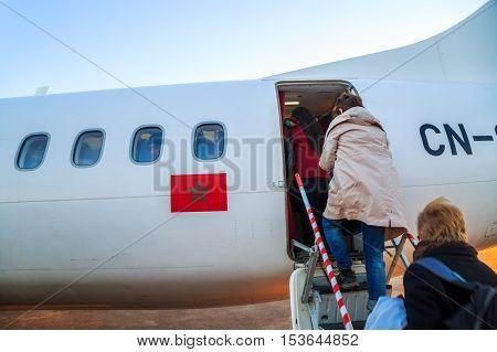 Ouarzazate, Morocco - Feb 28, 2016: Passengers Boarding Airplane Of Royal Air Morocco. People Climbi