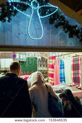 Vilnius Lithuania - December 27 2015: Stall with Woolen wraps at the Vilnius Christmas Market Lithuania. Selective focus