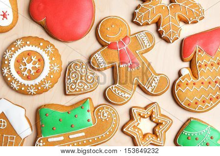 Tasty gingerbread cookies on wooden background