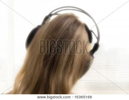 Early morning. Girl with headphones. Special computer modified image.