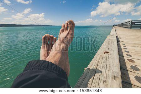 Man enjoying holiday at cornwallis beach, New Zealand.