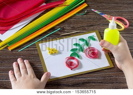 The Child Create Greeting Cards Origami Paper Honey And Garnet Tree Branch On A Wooden Table. Making
