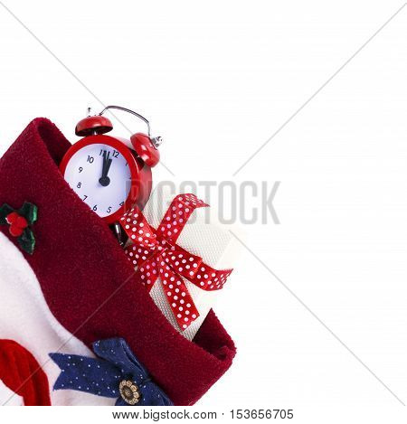 Christmas boot stocking with gift and alarm isolated on white background