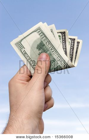 Man hand with convolute money.