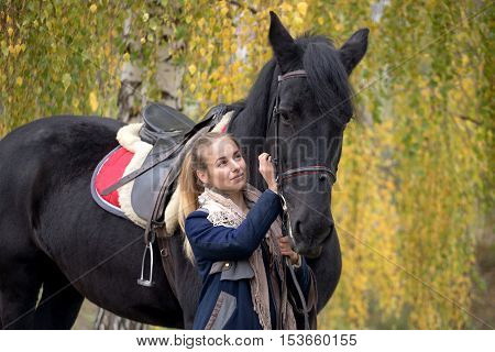 Girl With A Black Horse In The Autumn Under Birch