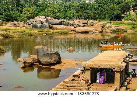 Hampi, India - November 20, 2012: Crossing Tungabhadra River in Hampi Karnataka India