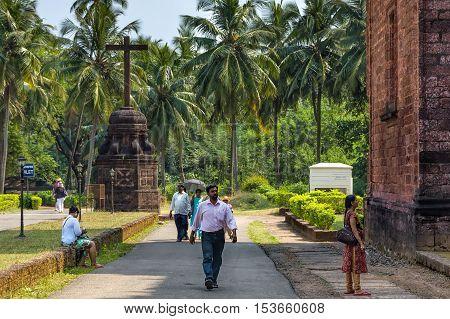 Old Goa India - November 13, 2012: Unidentified tourists visit to the famous landmark - Basilica of Bom Jesus or Borea Jezuchi Bajilika. Basilica - UNESCO World Heritage Site and functioning church.