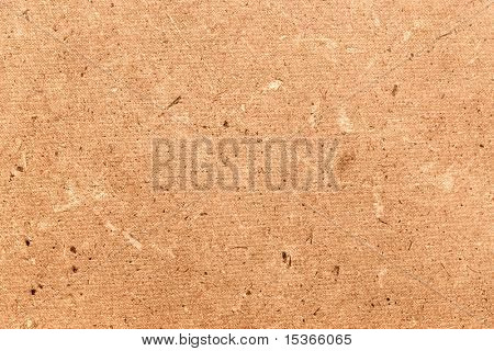 Rough dense cardboard. Texture or background.