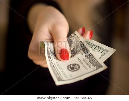 Woman hand giving money. Specially very small DOF.