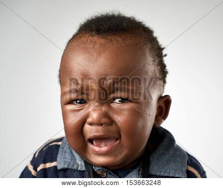 crying upset black african baby boy portrait
