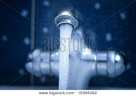 Water tap. Blue tint and low DOF.