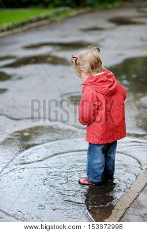 Adorable Toddler Girl At Rainy Day In Autumn