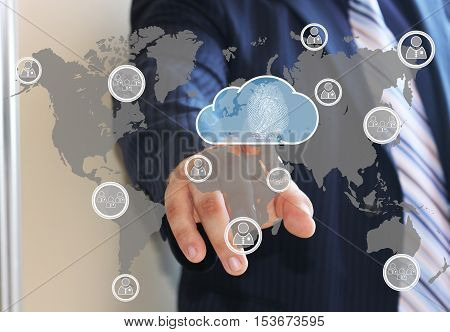 The businessman clicks on the icon for cloud data storage security on the touch screen with the world map. Security, protection of cloud data storage Business. The fingerprint scanner.
